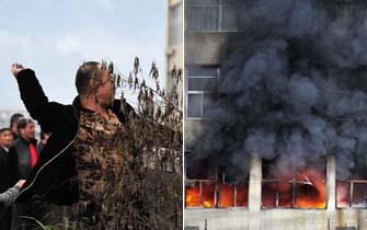 鞋厂起火 热心人爬楼顶砸窗救火