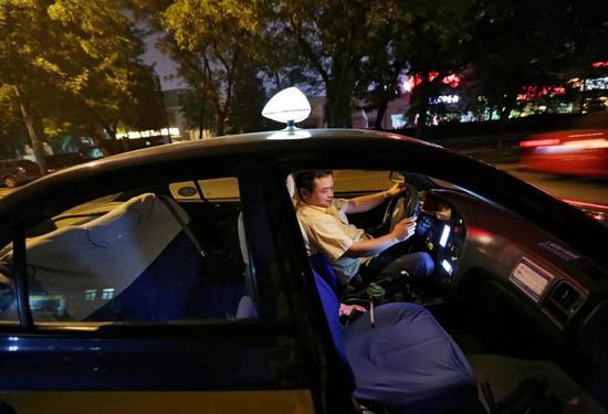 一些网约车司机开始跳回出租车行业。图/HowHweeYoung