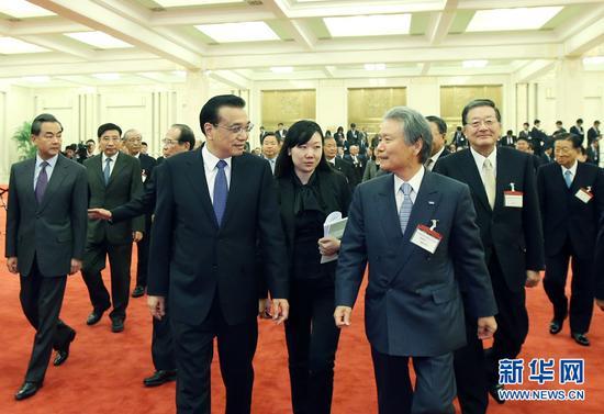 2015年11月,李克强在北京人民大会堂会见日本经济界代表团 图:新华社