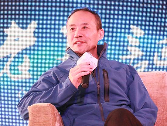 上图为万科企业股份有限公司董事会主席王石