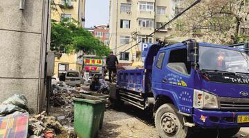 社区出资清理堆了近半年15吨垃圾