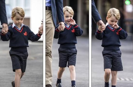 虽然乔治小王子全称嘟嘟嘴,满脸的委屈,但还是很有礼貌的和校长握了握手。
