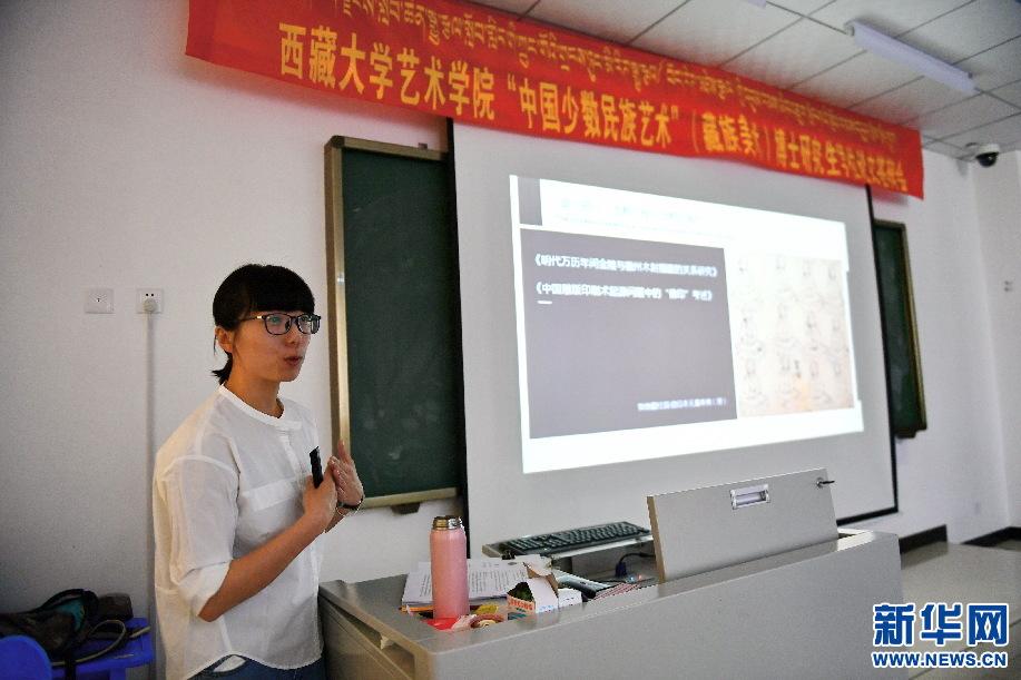 姜宇钦正在进行论文答辩(6月10日摄)。新华社记者 张汝锋 摄