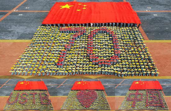 """北京科技大学2019级新生联合方阵拼出""""北科爱中国""""(学校供图)"""