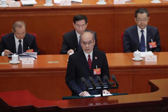 最高人民检察院检察长张军作工作报告。 新京报记者 彭子洋 摄