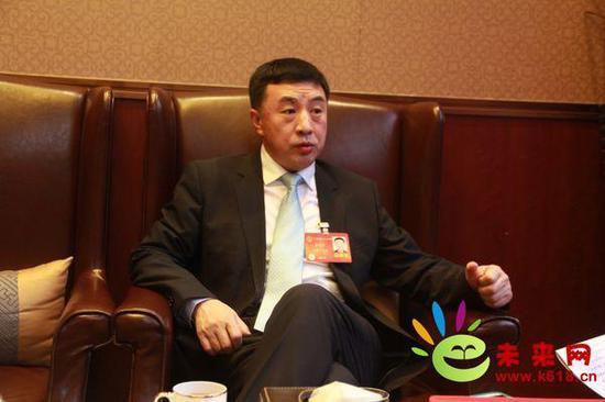 全国人大代表、中国宇华教育集团董事局主席李光宇