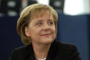默克尔为欧洲移民政策辩护 称将继续打击非法移民