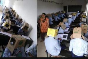 印度一学校让学生头戴纸箱防考试作弊(图)