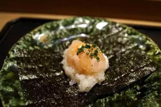 虎白餐厅招牌料理鳕鱼白子饭蒸