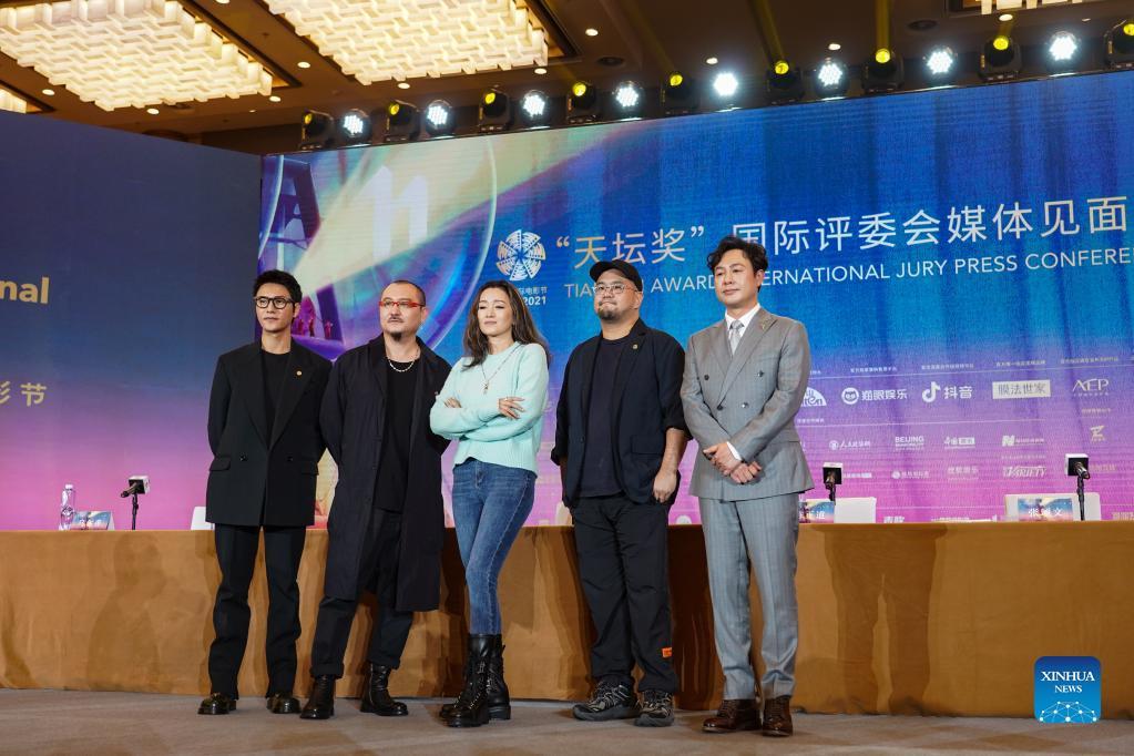 Tiantan Awards jury members of 11th Beijing Int'l Film Festival meet press