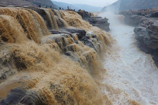 Annual spring flood seen in Hukou Waterfall scenic spot