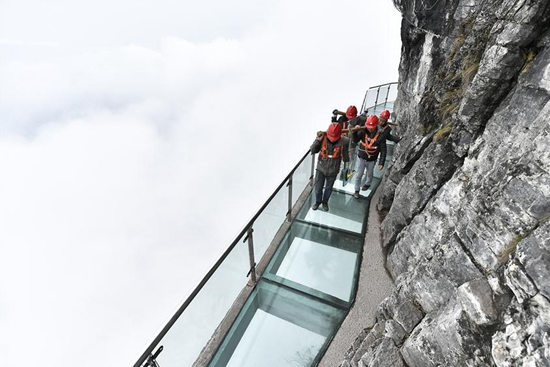 Workers replace glass pavement at Tianmenshan scenic area in China's Hunan