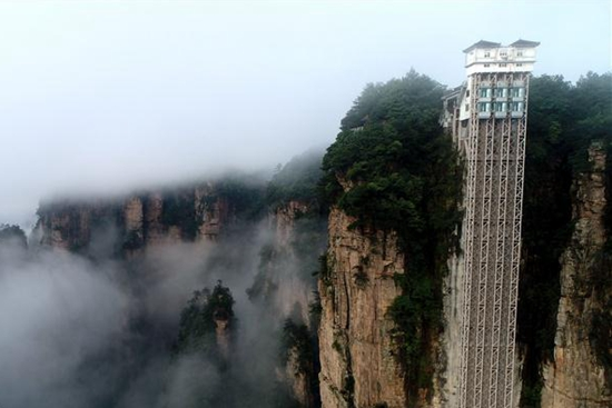 World's highest outdoor elevator shrouded by fog in Zhangjiajie, C China