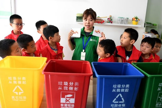 In pics: garbage sorting lesson for children in Hefei, China's Anhui