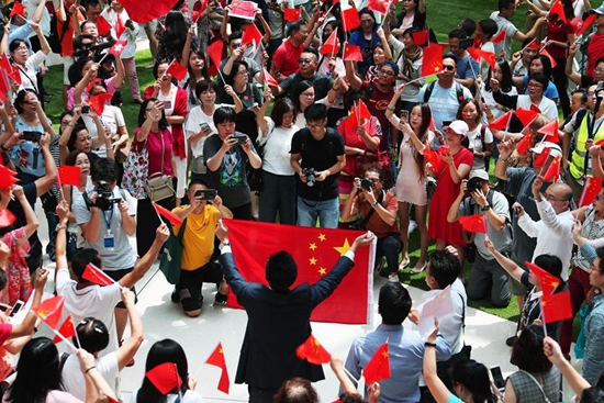 People chorus Chinese national anthem in Hong Kong to celebrate Mid-Autumn Festival