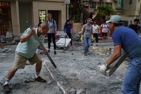 Local residents clear roadblocks in China's Hong Kong
