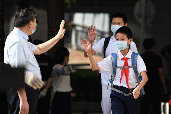 Students return to school in Beijing