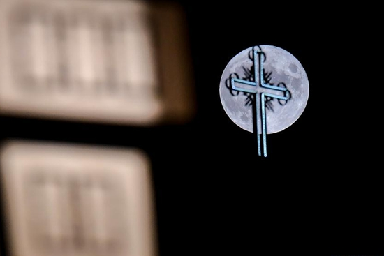 Full moon rises over church in North Macedonia