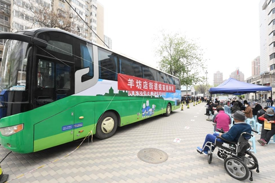 Mobile vaccination vehicles put into use in Beijing, Shanghai