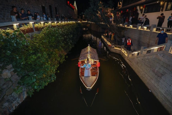 Visitors enjoy night time in Yanzhou ancient city