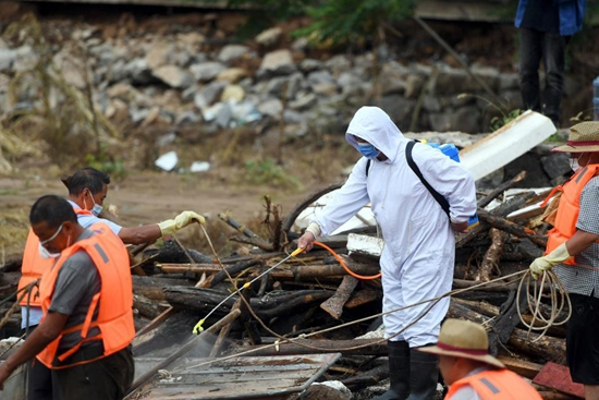 Disinfection, debris clean-up conducted in flood-hit Hebi City, C China