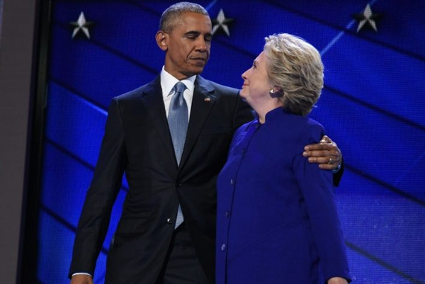 Obama passes torch to Clinton, warns election a test of democracy