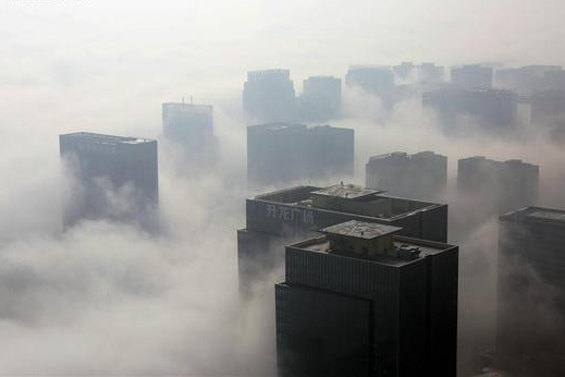 City of Zhengzhou cloaked by fog in central China's Henan
