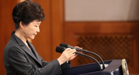 South Korean president hints prolonged impeachment battle, as tycoons deny seeking favors