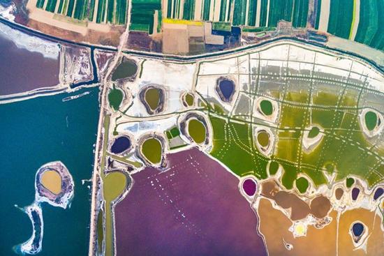 Aerial photos of colorful salt lake in N China's Shanxi