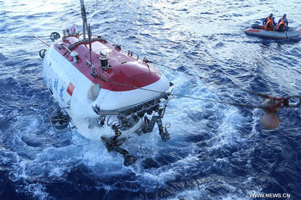 Manned submersible Jiaolong surfaces after its dive in Yap Trench, June 11, 2017. Jiaolong completed its 151th dive on Sunday since 2009. (Xinhua/Liu Shiping)
