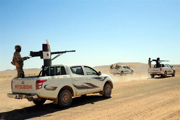Syrian military vehicles move in the Syrian desert at the countryside of the central Homs province near the Syrian-Iraqi borders, on June 12, 2017. The Syrian army recently announced that the Syrian forces and allied troops have completed the first stage of the military operation in the Syrian Desert, by reaching the Syrian-Iraqi borders after battles with the Islamic State (IS) group. (Xinhua/Ammar Safarjalani)