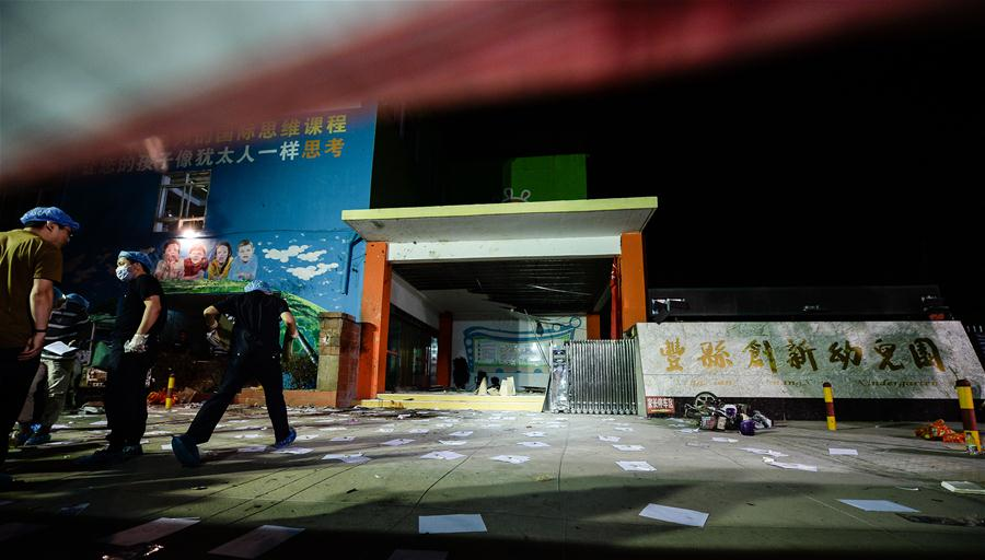 Forensic experts work at the site of the explosion near a kindergarten in Fengxian County in east China's Jiangsu Province, June 16, 2017. At least eight people have died and 66 people were injured after an explosion near a kindergarten in Fengxian County in east China's Jiangsu Province. (Xinhua/Li Xiang)