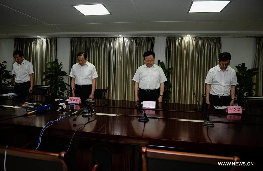 Officials mourn for the victims at a press conference about the explosion near a kindergarten in Fengxian County in east China's Jiangsu Province, June 16, 2017. At least eight people have died and 65 people were injured after an explosion near a kindergarten in Fengxian County. (Xinhua/Li Xiang)
