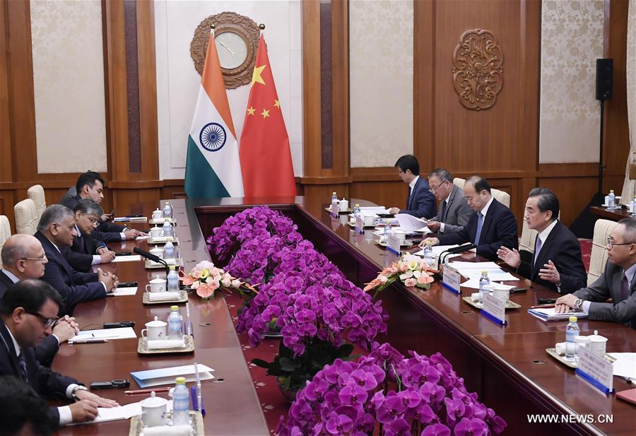 Chinese Foreign Minister Wang Yi (2nd R) meets with India's Minister of State for External Affairs Vijay Kumar Singh in Beijing, capital of China, June 18, 2017. (Xinhua/Yan Yan)