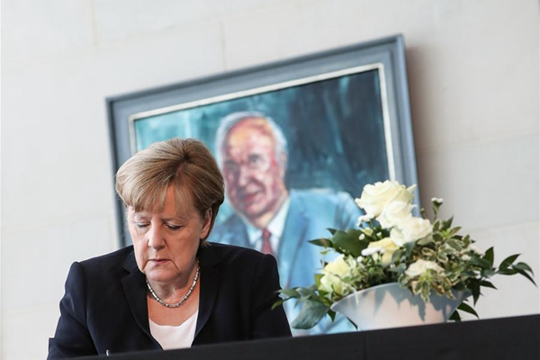 German Chancellor Angela Merkel signs the condolences book for former German Chancellor Helmut Kohl at German Chancellery in Berlin, capital of Germany, on June 18, 2017. Former German Chancellor Helmut Kohl died at his home in Germany's Ludwigshafen on Friday at the age of 87. (Xinhua/Shan Yuqi)