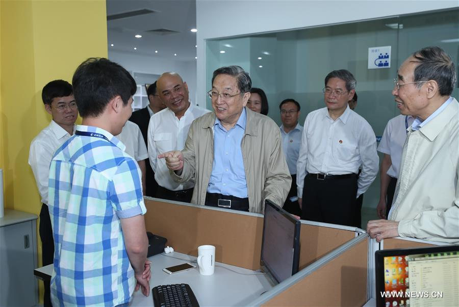 Yu Zhengsheng, chairman of the National Committee of the Chinese People's Political Consultative Conference, visits the Chang Hang Software company in southeast China's Fujian Province, June 16, 2017. Yu addressed the 9th Straits Forum held in Xiamen of Fujian on June 18. (Xinhua/Ma Zhancheng)