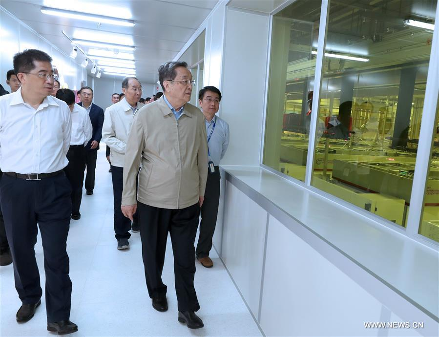 Yu Zhengsheng, chairman of the National Committee of the Chinese People's Political Consultative Conference, visits an integrated circuit maker in Xiamen, southeast China's Fujian Province, June 16, 2017. Yu addressed the 9th Straits Forum held in Xiamen on June 18. (Xinhua/Ma Zhancheng)