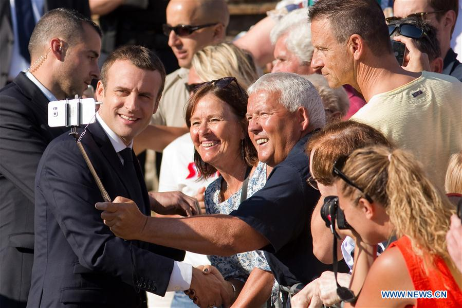 French President Emmanuel Macron poses for photo with his supporters after he voted at the city hall in the second round of the parliamentary elections in Le Touquet, France on June 18, 2017. (Xinhua/Kristina Afanasyeva)