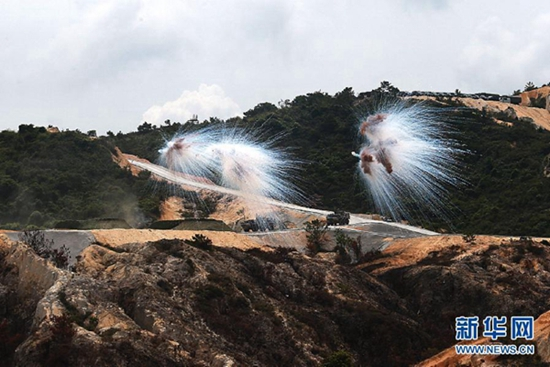 Hong Kong Garrison of PLA holds military drill in S China