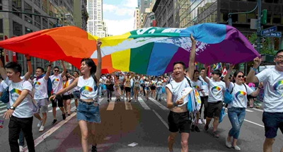 First Chinese Grand Marshal shines at NYC Pride March