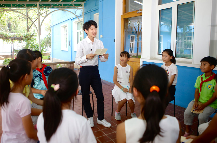 Chinese singer and actor, a member of the pop band TFBOYS, Wang Yuan shares his thoughts on quality education with 10 students from a primary school in suburban Beijing following an event in UNICEF China's Beijing office, where he was appointed as UNICEF Special Advocate for Education, on 28 June, 2017. Photo:UNICEF/China/2017/Xia Yong