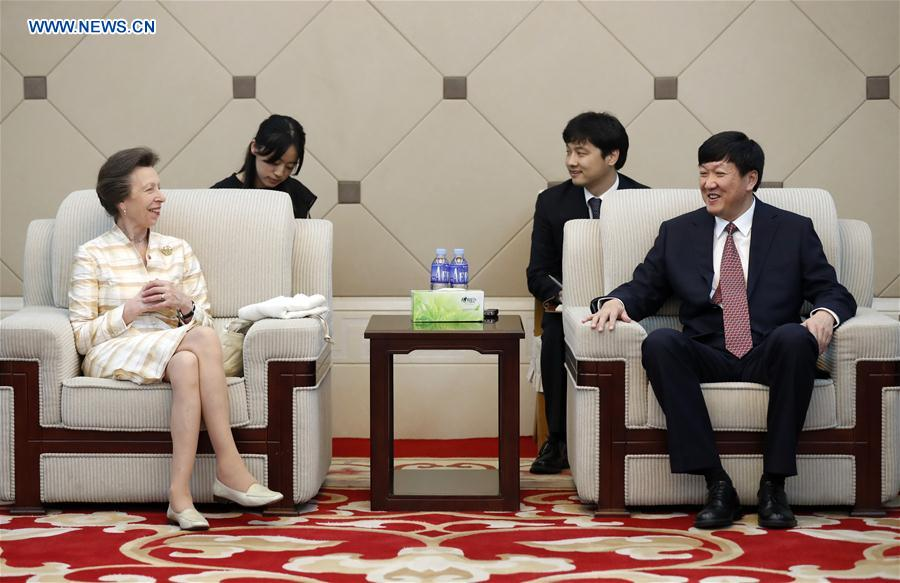 British Princess Anne(1st L) talks with Gao Zhidan, deputy director of the General Administration of Sport of China, before her visit to the Winter Sport Center of the General Administration of Sport of China in Beijing, capital of China, on July 5, 2017. (Xinhua/Wang Lili)