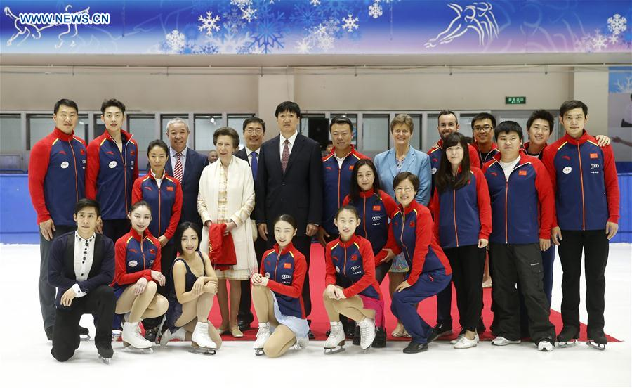 British Princess Anne (back, 5th L) poses for a group photo with officials, Chinese figure skating athletes and coaches at a training skating rink of the Winter Sport Center of the General Administration of Sport of China in Beijing, capital of China, on July 5, 2017. (Xinhua/Wang Lili)