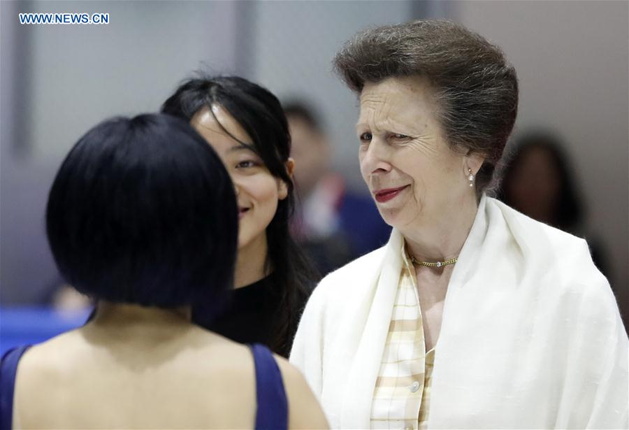 British Princess Anne (R) winks as she talks with Chinese figure skating world champion Sui Wenjing at a training skating rink of the Winter Sport Center of the General Administration of Sport of China in Beijing, capital of China, on July 5, 2017. (Xinhua/Wang Lili)