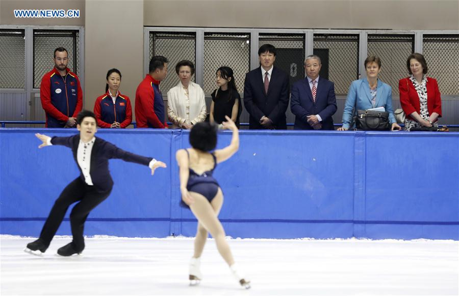 British Princess Anne(back, 4th L) looks on as Chinese figure skating world champions Sui Wenjing and Han Cong perform at a training skating rink in the Winter Sport Center of the General Administration of Sport of China in Beijing, capital of China, on July 5, 2017. (Xinhua/Wang Lili)