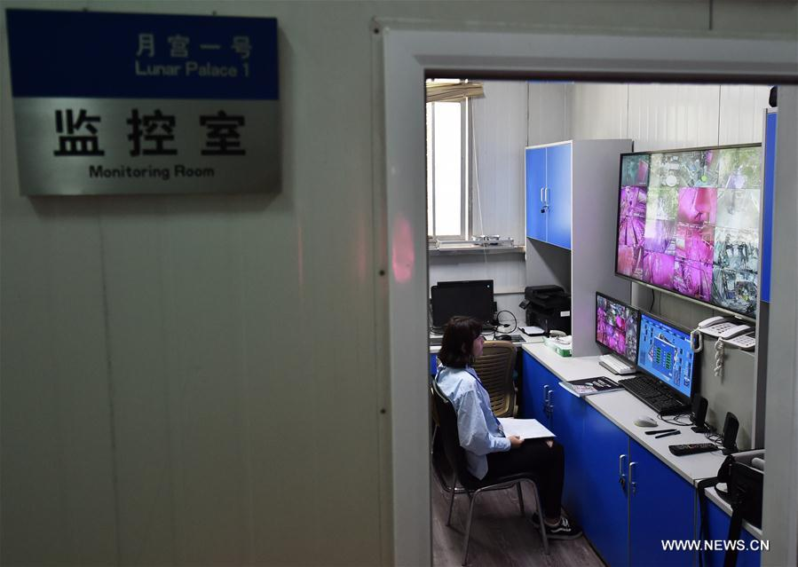 A staff worker monitors the status of volunteers in Yuegong-1 at Beihang University in Beijing, capital of China, July 9, 2017. The second volunteer group, two men and two women, replaced the first group and stepped into the simulated space