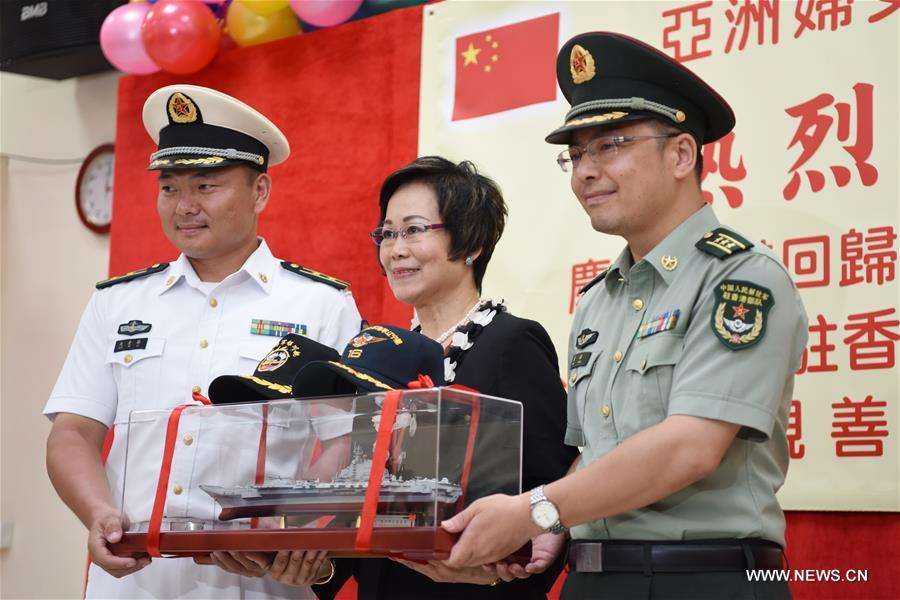 Officers of China's aircraft carrier Liaoning present souvenirs to the Ho Leung Kit Ting Care and Attention Home of Asia Women's League Limited in Hong Kong, south China, July 10, 2017. About 60 soldiers and officers of aircraft carrier Liaoning visited the elders of the care and attention home on Monday. (Xinhua/Wang Shen)