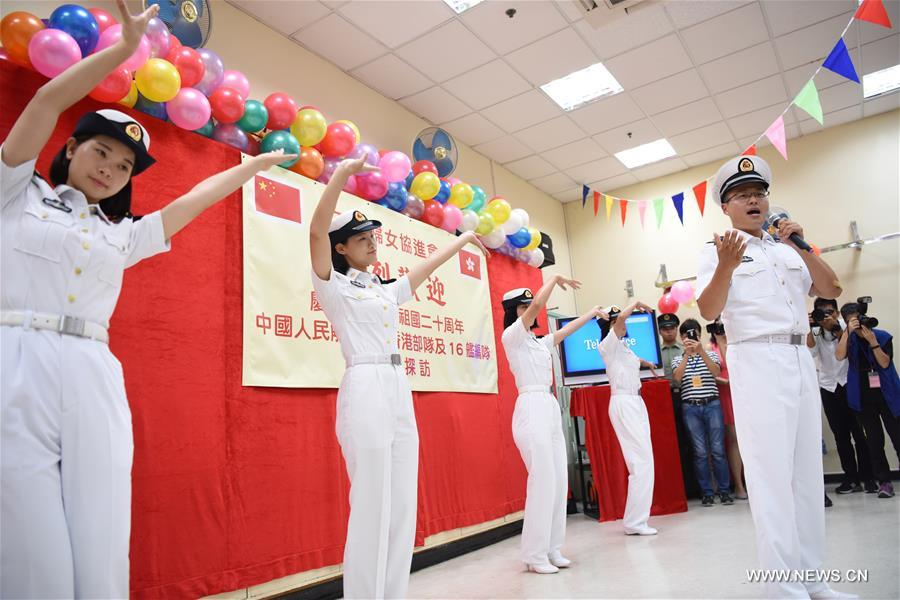 Soldiers of China's aircraft carrier Liaoning perform when visiting the Ho Leung Kit Ting Care and Attention Home of Asia Women's League Limited in Hong Kong, south China, July 10, 2017. About 60 soldiers and officers of aircraft carrier Liaoning visited the elders of the care and attention home on Monday. (Xinhua/Wang Shen)