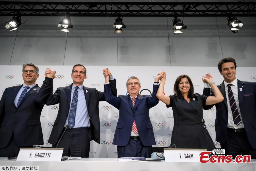 (L-R) Los Angeles 2024 Olympic bid's Chairman Casey Wasserman, Los Angeles' Mayor Eric Garcetti, International Olympic Committee (IOC)'s President German Thomas Bach, Mayor of Paris Anne Hidalgo and Paris 2024 Olympic bid's Co-president Tony Estanguet pose during a press conference following an IOC extraordinary session on July 11, 2017 in Lausanne. The International Olympic Committee agreed to award the 2024 and 2028 Games at the same time, effectively guaranteeing that Paris and Los Angeles will be the hosts.(Photo/Agencies)