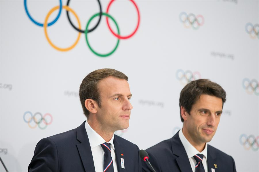 French President Emmanuel Macron (L) and Paris 2024 Olympic bid co-president Tony Estanguet hold a press conference after the presentation of the Paris 2024 Candidate City Briefing for International Olympic Committee (IOC) members at the SwissTech Convention Centre, in Lausanne, Switzerland, July 11, 2017. [Photo/Xinhua]
